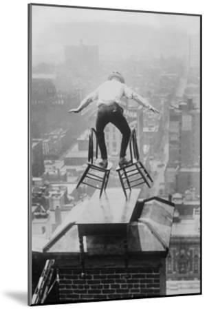 Reynolds Performs a Balancing Act on Roof in New York City--Mounted Art Print