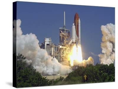 Space Shuttle Discovery-Paul Kizzle-Stretched Canvas Print