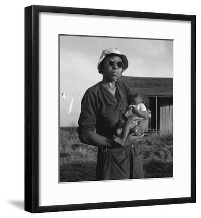 Wife and Child of Tractor Driver-Dorothea Lange-Framed Art Print
