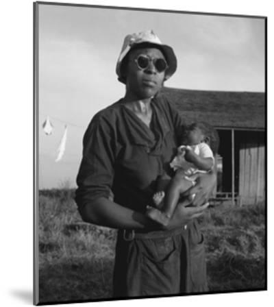Wife and Child of Tractor Driver-Dorothea Lange-Mounted Art Print