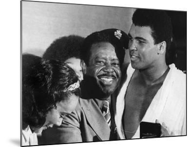 Muhammad Ali Appears with Civil Rights Activists, Ralph Abernathy and Coretta Scott King-Robert Johnson-Mounted Photographic Print