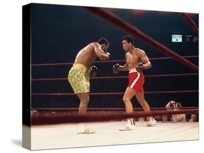 """Muhammad Ali and Joe Frazier, """"Fight of the Year"""", March 8, 1971-Moneta Sleet Jr.-Stretched Canvas Print"""