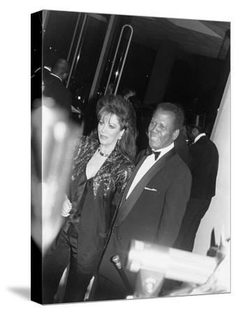Sidney Poitier and Jackie Collins - 1990-Isaac Sutton-Stretched Canvas Print