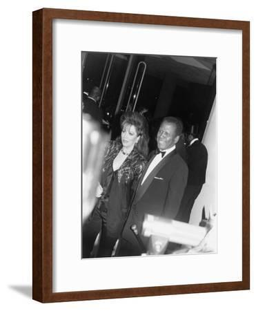 Sidney Poitier and Jackie Collins - 1990-Isaac Sutton-Framed Photographic Print