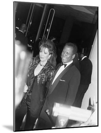 Sidney Poitier and Jackie Collins - 1990-Isaac Sutton-Mounted Photographic Print