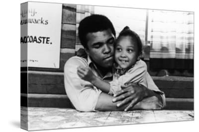 Muhammad Ali; Maryum Ali - 1974-Leroy Patton-Stretched Canvas Print