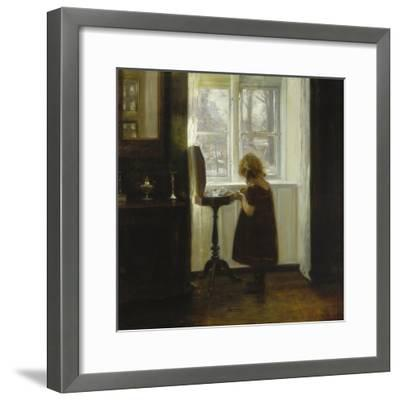 A Girl Standing by a Sewing Table-Carl Holsoe-Framed Giclee Print