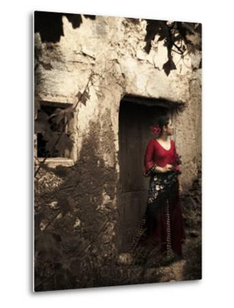 A Young Spanish Woman Wearing Traditional Flamenco Dress Standing in a Doorway to an Old Building-Steven Boone-Metal Print