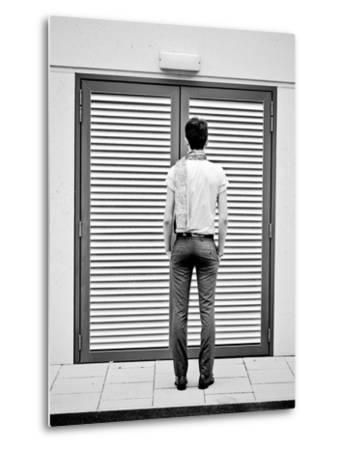 A Young Man Standing in the Street Looking at a Pair of Doors-India Hobson-Metal Print