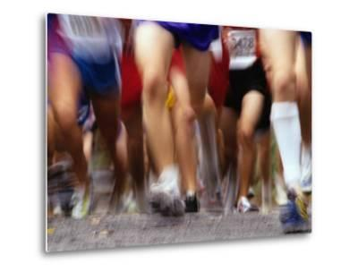 Blurred Action of Runner's Legs Competing in a Race--Metal Print