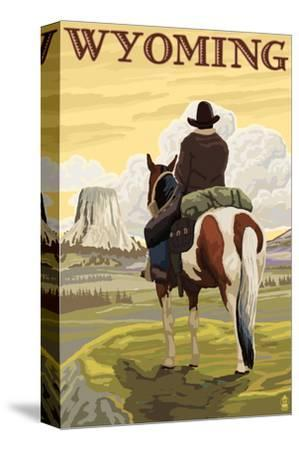 Cowboy and Devil's Tower - Wyoming-Lantern Press-Stretched Canvas Print