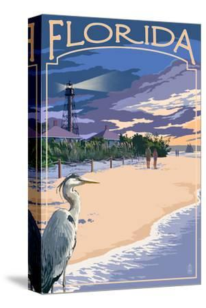 Florida - Lighthouse and Blue Heron Sunset-Lantern Press-Stretched Canvas Print