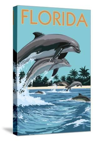 Florida - Dolphins Jumping-Lantern Press-Stretched Canvas Print