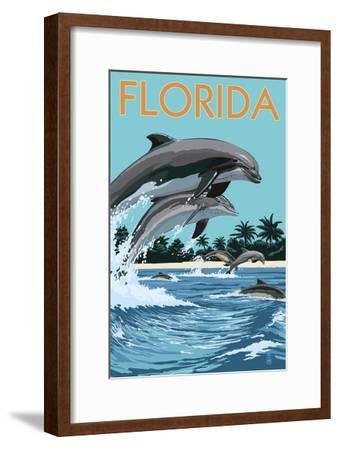 Florida - Dolphins Jumping-Lantern Press-Framed Art Print