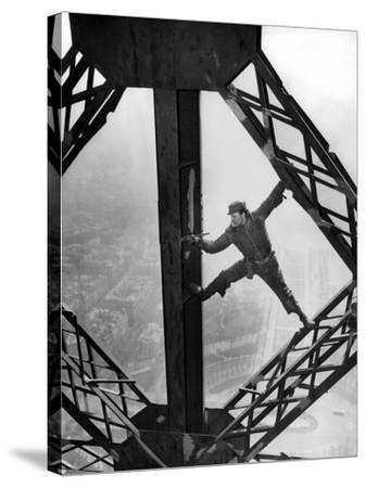 Worker Painting the Eiffel Tower--Stretched Canvas Print