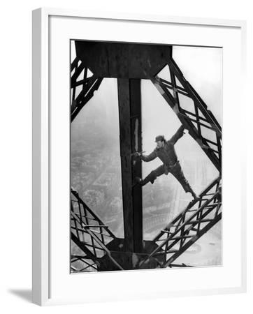 Worker Painting the Eiffel Tower--Framed Photo