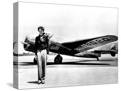 Amelia Earhart Standing in Front of the Lockheed Electra in Which She Disappeared in July 29, 1937--Stretched Canvas Print