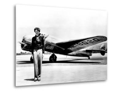 Amelia Earhart Standing in Front of the Lockheed Electra in Which She Disappeared in July 29, 1937--Metal Print