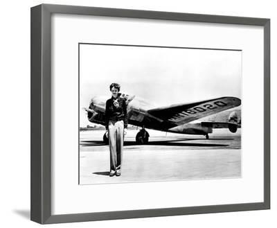 Amelia Earhart Standing in Front of the Lockheed Electra in Which She Disappeared in July 29, 1937--Framed Photo