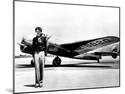 Amelia Earhart Standing in Front of the Lockheed Electra in Which She Disappeared in July 29, 1937--Mounted Photo