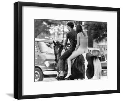 A Naked Young Women and Escort Ride a Horse Through Goose Lake Park at 3 Day Rock Music Festival--Framed Photo