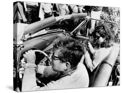 Pres Kennedy Drives an Open Car in Newport, Rhode Island--Stretched Canvas Print