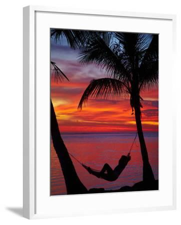 Woman in Hammock, and Palm Trees at Sunset, Coral Coast, Viti Levu, Fiji, South Pacific-David Wall-Framed Photographic Print