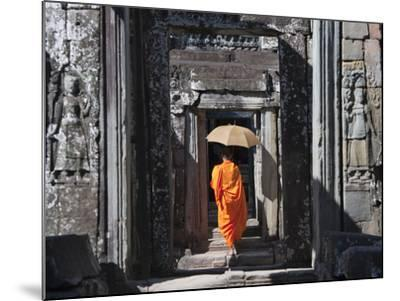 Monk with Buddhist Statues in Banteay Kdei, Cambodia-Keren Su-Mounted Photographic Print