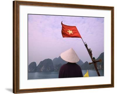 Girl with Conical Hat on a Junk Boat with National Flag and Karst Islands in Halong Bay, Vietnam-Keren Su-Framed Photographic Print