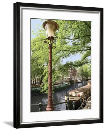 Old Gas Lamp Post and Bicycles on a Bridge over a Canal in Amsterdam, the Netherlands-Miva Stock-Framed Photographic Print