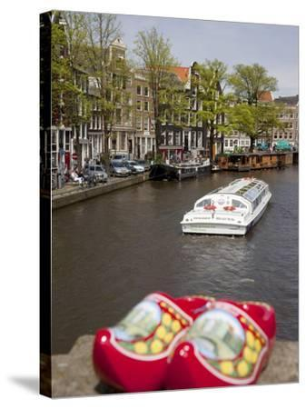 Souvenir Clogs and Canal, Amsterdam, Holland, Europe-Frank Fell-Stretched Canvas Print