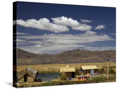 Floating Islands of Uros People, Traditional Reed Boats and Reed Houses, Lake Titicaca, Peru-Simon Montgomery-Stretched Canvas Print