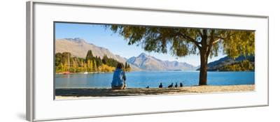 Panorama of Tourist Relaxing by Lake Wakatipu in Autumn at Queenstown, Otago, New Zealand-Matthew Williams-Ellis-Framed Photographic Print