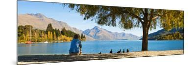 Panorama of Tourist Relaxing by Lake Wakatipu in Autumn at Queenstown, Otago, New Zealand-Matthew Williams-Ellis-Mounted Photographic Print
