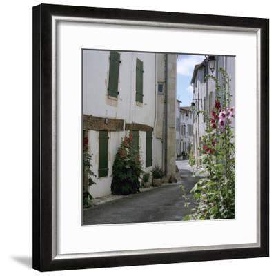 Typical Street Scene with Hollyhocks, St. Martin, Ile de Re, Poitou-Charentes, France, Europe-Stuart Black-Framed Photographic Print