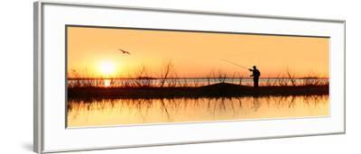 Silhouette of a Man Fishing--Framed Photographic Print