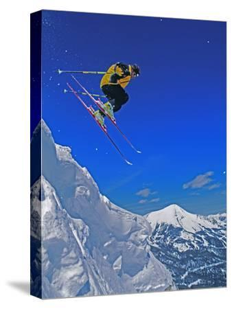 A Skier Jumps a Cornice at Exclusive Yellowstone Club Ski Area, Montana-Gordon Wiltsie-Stretched Canvas Print