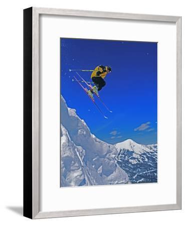 A Skier Jumps a Cornice at Exclusive Yellowstone Club Ski Area, Montana-Gordon Wiltsie-Framed Photographic Print