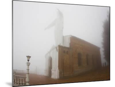 Thick Fog Engulfing the Santuario De Guadalupe Christ Statue-Mike Theiss-Mounted Photographic Print