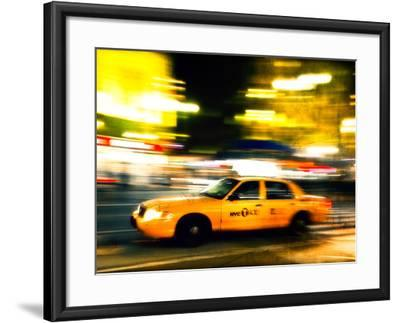 A NY Taxi Cab Rushes By-Jorge Fajl-Framed Photographic Print