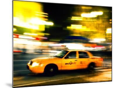 A NY Taxi Cab Rushes By-Jorge Fajl-Mounted Photographic Print