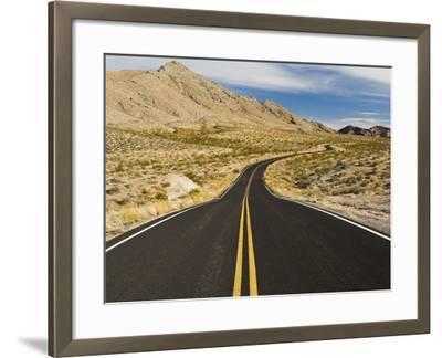 A Road Through and Arid Desert Landscape-James Forte-Framed Photographic Print