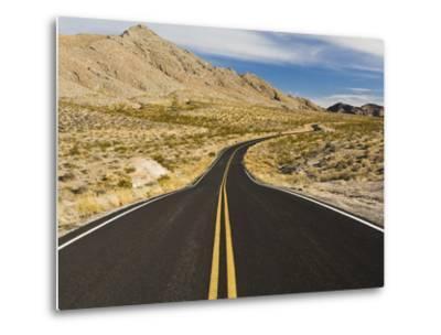 A Road Through and Arid Desert Landscape-James Forte-Metal Print
