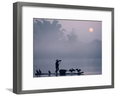 A Fisher Uses Cormorants to Capture Fish from the Li River at Sunrise-Kenneth Ginn-Framed Photographic Print