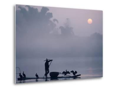 A Fisher Uses Cormorants to Capture Fish from the Li River at Sunrise-Kenneth Ginn-Metal Print