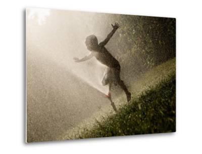 A Boy Plays in a Sprinkler on a Hot Summer Day-Heather Perry-Metal Print