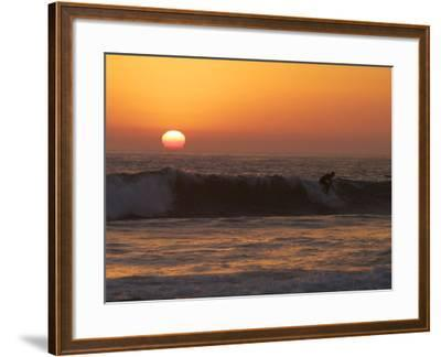 Surfer Riding a Wave at Sunset over the Pacific Ocean-Tim Laman-Framed Photographic Print