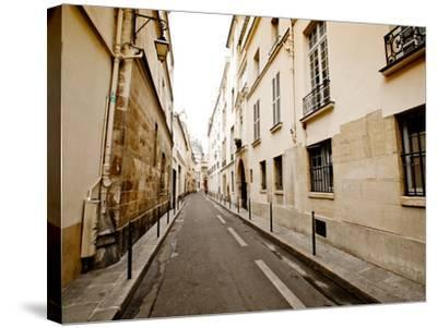 A Small Street Lined with Traditional Parisian Buildings-Jorge Fajl-Stretched Canvas Print