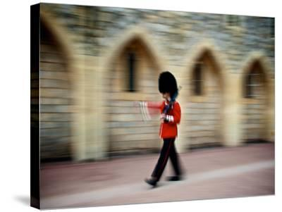 A Queen's Guard with a Rifle Walking Outside Windsor Castle-Heather Perry-Stretched Canvas Print