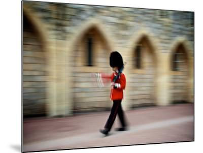 A Queen's Guard with a Rifle Walking Outside Windsor Castle-Heather Perry-Mounted Photographic Print